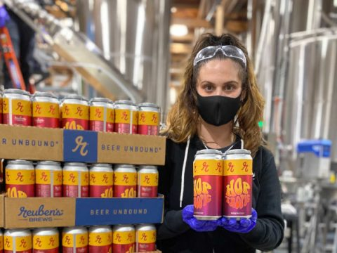 hop tropic cans from Reuben's Brews and Zeeks Pizza