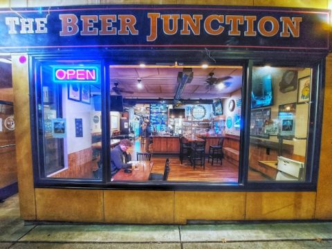 The Beer Junction, open sign in the window.