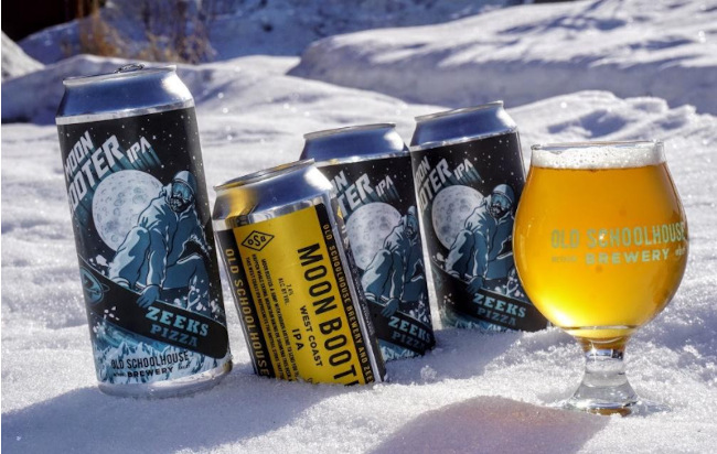 cans of Moon Booter IPA in the snow.